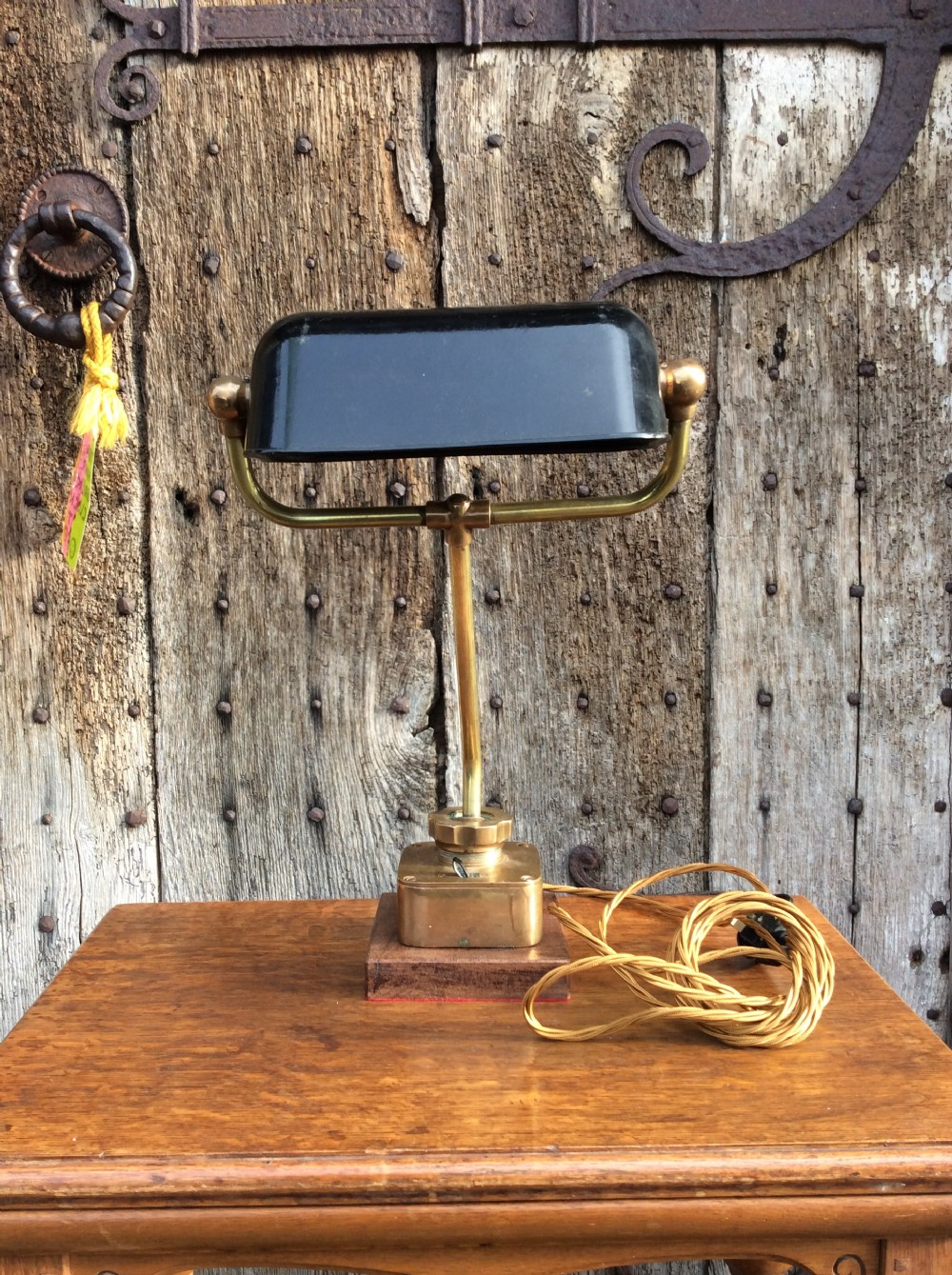 an early 20thc heavy quality brass table lamp