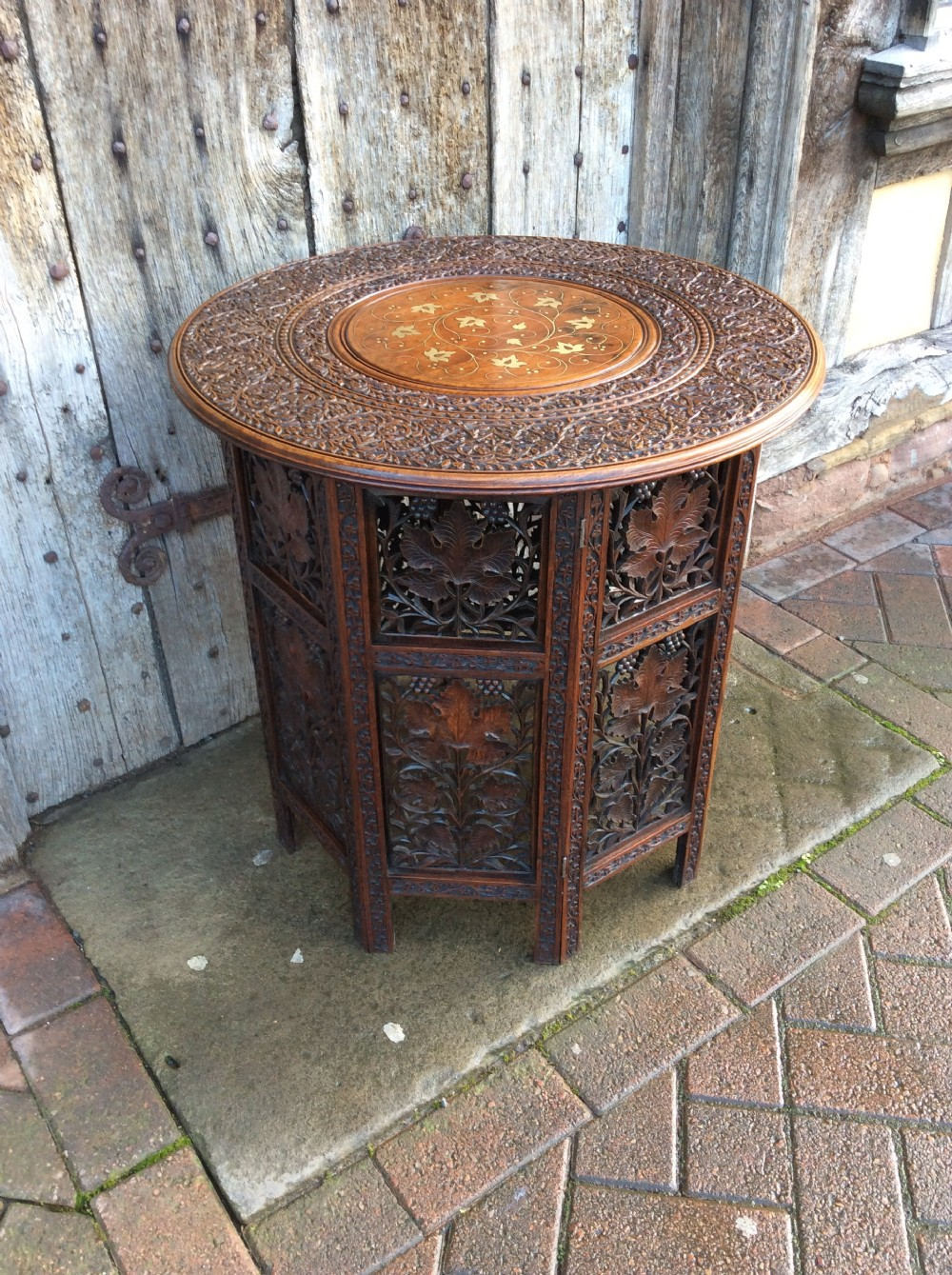 a brass inlay moorish folding table