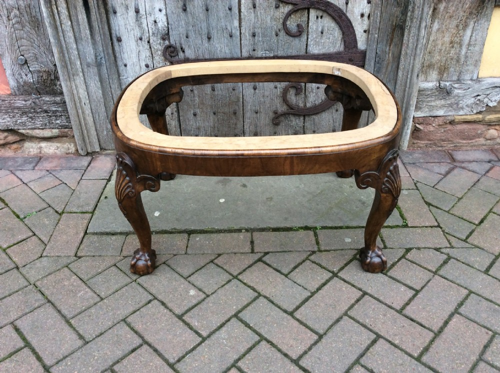 an oversized chippendale style walnut stool