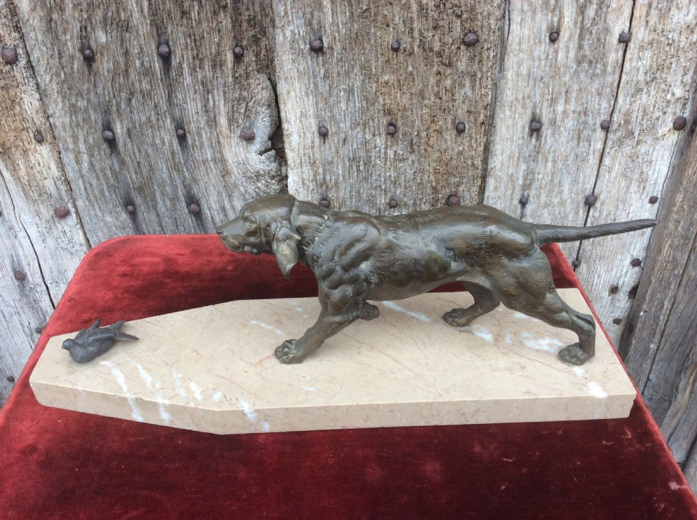 a 20thc bronze of a working dog on marble plinth